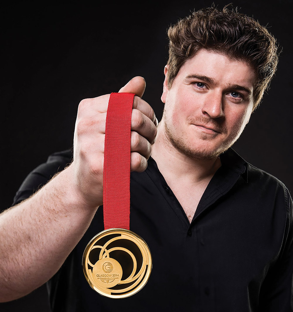 2007 awardee Jonathan Boyd with the medal he designed for the 2014 Commonwealth Games.